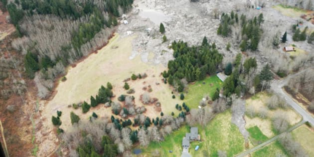 SNOHOMISH COUNTY, WASHINGTON - MARCH 22:  In this handout from Washington State Dept of Transportation, an aerial of a mudslide that covered SR 530 March 22, 2014 between Darrington and Arlington, Washington. Eight people have been confirmed dead and at least 18 others are still missing after a massive mudslide leveled homes and blocked a river and a road. (Photo by Washington State Dept of Transportation via Getty Images)