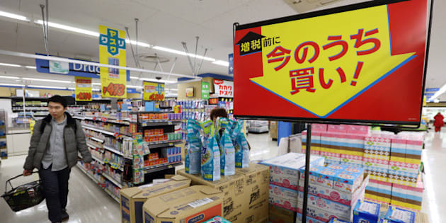 Signage displays sale prices as customers shop at a Seiyu GK supermarket, a discount chain owned by Wal-Mart Stores Inc., in Tokyo, Japan, on Thursday, March, 13, 2014. Companies and consumers have rushed to make purchases before April, with industrial production rising the most in January since June 2011 and retail sales gaining at the fastest pace since April 2012. Photographer: Tomohiro Ohsumi/Bloomberg via Getty Images