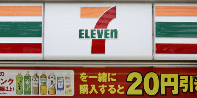 A woman enters a 7-Eleven convenience store, operated by Seven & I Holdings Co., in Kawasaki City, Kanagawa Prefecture, Japan, on Tuesday, May 28, 2013. Seven & I, the operator of 7-Eleven convenience stores, plans more acquisitions in the U.S. and may more than double North America outlets as consumer spending improves in the largest economy. Photographer: Akio Kon/Bloomberg via Getty Images