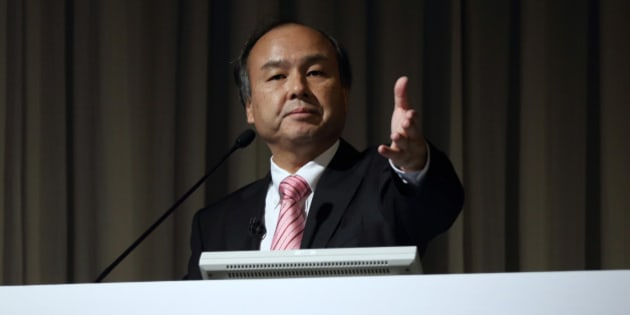 Billionaire Masayoshi Son, chairman and chief executive officer of SoftBank Corp., gestures to a reporter during a news conference in Tokyo, Japan, on Wednesday, Feb. 12, 2014. SoftBank posted third-quarter profit that beat analyst estimates as the release of Apple Inc.'s new iPhones spurred the addition of 2.3 million subscribers. Photographer: Tomohiro Ohsumi/Bloomberg via Getty Images