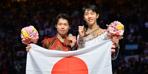 SAITAMA, JAPAN - MARCH 28:  (L to R)  Tatsuki Machida (Silver) of Japan and  Yuzuru Hanyu (Gold) of Japan pose with medal in the victory ceremony during ISU World Figure Skating Championships at Saitama Super Arena on March 28, 2014 in Saitama, Japan.  (Photo by Atsushi Tomura/Getty Images)