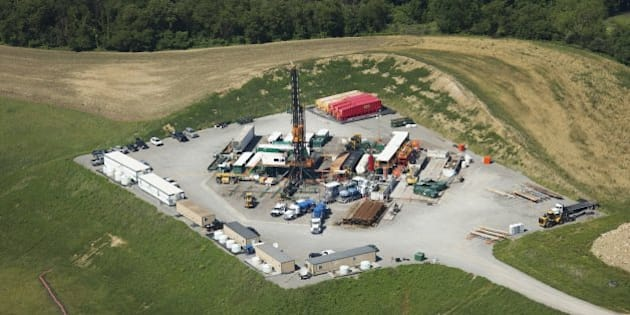 Fracking rigs like this one in Butler County, Penn., dot the landscape across western Pennsylvania, June 19, 2013. Fracking, the controversial drilling technique that is driving America's energy boom, has been around for decades. But it was only in the last decade that the process of blasting underground rocks with water and chemicals was refined enough to deliver a long sought oil and gas bounty and stir a furious debate over its health and environmental consequences. (Jason Cohn/MCT via Getty Images)