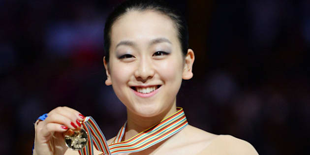 SAITAMA, JAPAN - MARCH 29:  Mao Asada (Gold) of Japan poses with medal in the victory ceremony during ISU World Figure Skating Championships at Saitama Super Arena on March 29, 2014 in Saitama, Japan.  (Photo by Atsushi Tomura/Getty Images)