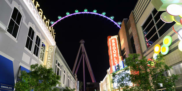 LAS VEGAS, NV - MARCH 30:  A general view of people at The LINQ with the Las Vegas High Roller in the background on March 30, 2014 in Las Vegas, Nevada. The 550-foot-tall attraction is the highest observation wheel in the world and features 28 spherical cabins that can hold up to 40 people each.  (Photo by Ethan Miller/Getty Images)