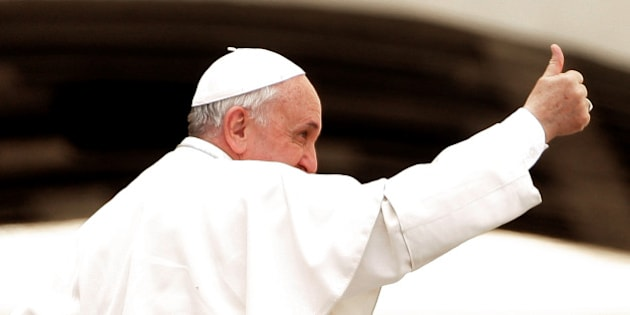 VATICAN CITY, VATICAN - APRIL 02:  Pope Francis waves to the faithful as he leaves at the end of his weekly audience in St. Peter's Square on April 2, 2014 in Vatican City, Vatican. Tomorrow the Holy Father will receive Queen Elizabeth II and Prince Philip, Duke of Edinburgh.  (Photo by Franco Origlia/Getty Images)