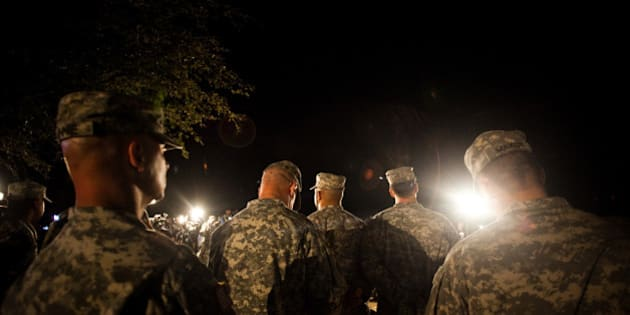 FORT HOOD, TX - APRIL 2, 2014: Soldiers watch over General Mark Milley, III Corps and Fort Hood Commanding General, as he speaks to media during a press conference about a shooting that occurred earlier in the day at Fort Hood Military Base on April 2, 2014 in Fort Hood, Texas.  Milley confirmed that four people were dead in the shooting, including the gunman himself. (Photo by Drew Anthony Smith/Getty Images)