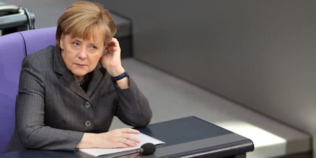 BERLIN, GERMANY - FEBRUARY 13:  German Chancellor Angela Merkel attends a meeting of the Bundestag, or German federal Parliament, on February 13, 2014 in Berlin, Germany. In a government policy statement, or Regierungserklaerung, Vice Chancellor and Economy and Energy Minister Sigmar Gabriel (SPD) said he wants to see more financial strengthening of German cities and local communities, as well as an 8.50 EUR an hour minimum wage, a proposal met with opposition by Sahra Wagenknecht of the Left party (Die Linken), who insisted that 10 EUR an hour is a fairer salary.  (Photo by Adam Berry/Getty Images)