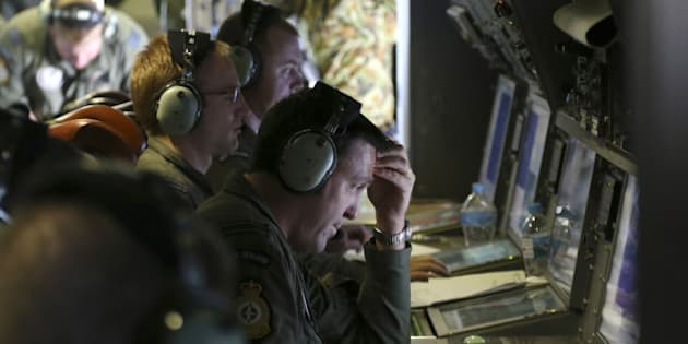 AT SEA - APRIL 04: Operators monitor TAC stations onboard a RNZAF P3 Orion during search operations for wreckage and debris of missing Malaysia Airlines Flight MH370 in Southern Indian Ocean on April0 4, 2014, near Australia.  Up to fourteen planes and nine ships resumed in the search for missing Malaysia Airlines flight MH370 in the Indian Ocean off the coast of Western Australia today. The airliner disappeared on March 8 with 239 passengers and crew on board and is suspected to have crashed into the southern Indian Ocean. (Photo by Nick Perry - Pool/Getty Images)