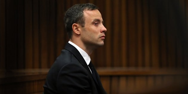 South African Paralympic track star Oscar Pistorius attends his trial in Court in Pretoria on April 7, 2014. As the defence opens its case, the 27-year-old Paralympian will give the court his first account of why he shot dead his model girlfriend Reeva Steenkamp in the early hours of Valentine's Day in 2013.    POOL AFP PHOTO Themba Hadebe        (Photo credit should read THEMBA HADEBE/AFP/Getty Images)