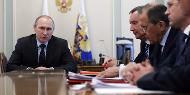 Russia's President Vladimir Putin attends a meeting with members of the government at the Novo-Ogaryovo state residence outside Moscow, April 9, 2014. Putin on April 9 ordered Ukraine to come to the negotiating table over its unpaid energy bills, warning that it would otherwise require payment in advance for gas. Ukraine 'would receive only what they have paid for' if they failed to negotiate, Putin was quoted as saying by Russian news agencies. AFP PHOTO / POOL / SERGEI KARPUKHIN        (Photo credit should read SERGEI KARPUKHIN/AFP/Getty Images)