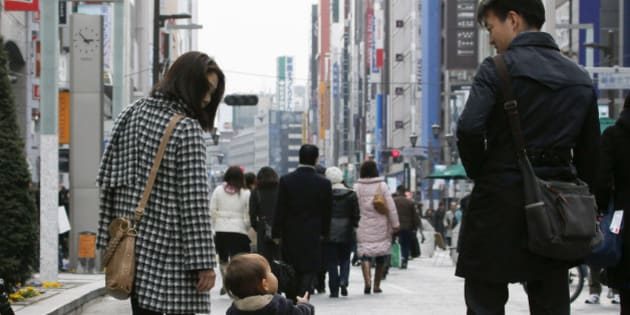 A family walks through the Ginza district of Tokyo, Japan, on Monday, Feb. 15, 2010. Japan's economic growth accelerated last quarter as a global trade revival fueled demand for the nation's exports. Photographer: Kimimasa Mayama/Bloomberg via Getty Images