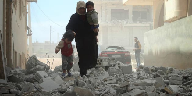 IDLIB, SYRIA - APRIL 15:  Air operations by Assad's forces were destroyed buildings in the northwestern city of Idlib, Syria on April 15, 2014. (Photo by Umit Erdogan/Anadolu Agency/Getty Images)