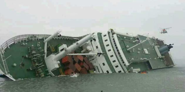 JINDO-GUN, SOUTH KOREA - APRIL 16: In this handout image provided by the Republic of Korea Coast Guard, a passenger ferry sinks off the coast of Jindo Island on April 16, 2014 in Jindo-gun, South Korea. The ferry identified as the Sewol was carrying about 470 passengers, including students and teachers, traveling to Jeju island.  (Photo by The Republic of Korea Coast Guard via Getty Images)