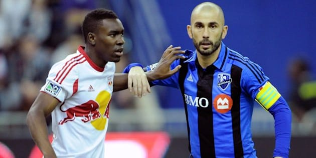 MONTREAL, QC - APRIL 5:  Lloyd Sam #10 of the New York RedBulls defends against Marco Di Vaio #9 of the Montreal Impact during the MLS game at the Olympic Stadium on April 5, 2014 in Montreal, Quebec, Canada.  (Photo by Richard Wolowicz/Getty Images)