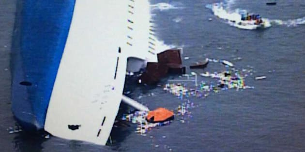 JINDO-GUN, SOUTH KOREA - APRIL 16:  In this screen shot handout of helicopter camera provided by the Republic of Korea Coat Guard, the ferry is seen sinking off as the rescue work continues the coast of Jindo Island on April 16, 2014 in Jindo-gun, South Korea. Two people are dead, and more than ninety are missing as reported. The ferry identified as the Sewol was carrying about 470 passengers, including the students and teachers, traveling to Jeju island. (Photo by The Republic of Korea Coast Guard via Getty Images)