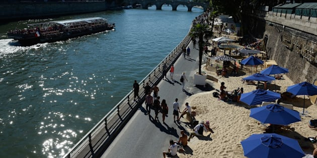 PARIS, FRANCE - AUGUST 01:  General view of 'Paris Plage', an artificial beach set up on the right bank of the Seine river is seen on August 1, 2013 in Paris, France.  (Photo by Pascal Le Segretain/Getty Images)