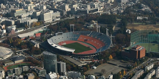 The National Olympic Stadium, center, stands in this aerial photograph taken in Tokyo, Japan, on Monday, Dec. 2, 2013. Japan's gross domestic product rose an annualized 1.9 percent in the July-September period after gaining 3.8 percent the previous quarter, the Cabinet Office reported on Nov. 14. Photographer: Tomohiro Ohsumi/Bloomberg via Getty Images