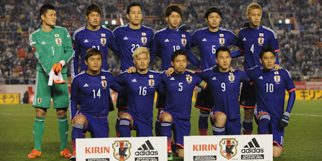 TOKYO, JAPAN - MARCH 05:  (EDITORIAL USE ONLY) Japan line up for team photos prior to the Kirin Challenge Cup international friendly match between Japan and New Zealand at National Stadium on March 5, 2014 in Tokyo, Japan.  (Photo by Kaz Photography/Getty Images)
