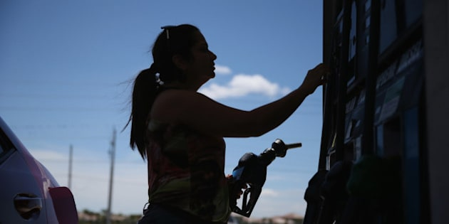 PEMBROKE PINES, FL - APRIL 21:  Dora Galeano pumps gas at the Victory gas station on April 21, 2014 in Pembroke Pines, Florida. According to the Lundberg Survey the average price for a gallon of regular gas is now $3.69- the highest price since March of last year.  (Photo by Joe Raedle/Getty Images)