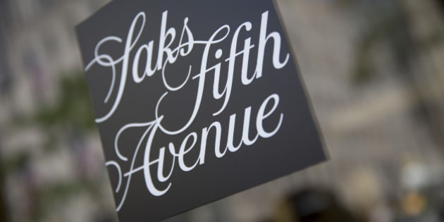 The Saks Fifth Avenue logo is displayed at the company's store in New York, U.S., on Monday, July 29, 2013. Hudson's Bay Co. agreed to buy Saks Inc. for $2.4 billion, combining Canada's largest-department store chain with one of the most prestigious U.S. luxury retailers in a deal that may spur the creation of a real estate investment trust. Photographer: Scott Eells/Bloomberg via Getty Images