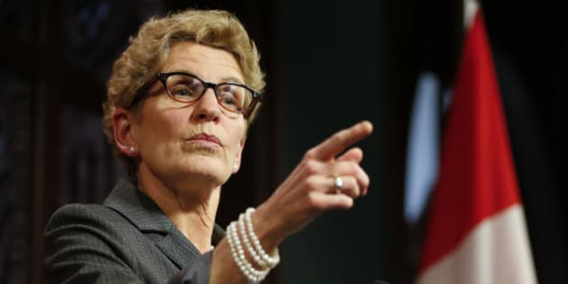 TORONTO, ON - MARCH 26: Premier Kathleen Wynne responds to breach of trust allegations made by Tim Hudak at Queen's Park Thursday evening. March 26, 2014.        (Lucas Oleniuk/Toronto Star via Getty Images)