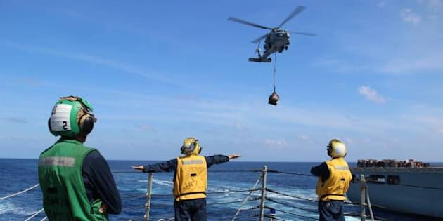 """U.S. Navy sailors use hand signals while directing helicopter operations onboard the Arleigh Burke-class destroyer USS Kidd (DDG 100). Kidd is currently conducting search and rescue operations for the missing Malaysian Airlines flight MH370. The flight had 227 passengers from 14 nations, mainly China, and 12 crew members. (U.S. Navy photo by Logistics Specialist 2nd Class Karmowska-Brooks/RELEASED)   Date Taken:03.17.2014  Date Posted:03.17.2014 11:27  Photo ID:1188494  VIRIN:140317-N-ZZ999-001  Resolution:1500x1000  Size:157.17 KB  Location:USS KIDD, AT SEA  Read more: <a href=""""http://www.dvidshub.net/image/1188494/uss-kidd-conducts-search-and-rescue-operations-missing-malaysian-airlines-flight-mh370#.Uycd2V5kJak#ixzz2wEl9DzYF"""" rel=""""nofollow"""">www.dvidshub.net/image/1188494/uss-kidd-conducts-search-a...</a>"""