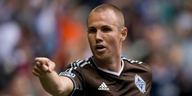 Vancouver Whitecaps' Kenny Miller, of Scotland, celebrates after scoring a goal against the New England Revolution during the first half of an MLS soccer game in Vancouver, B.C., on Saturday June 15, 2013. THE CANADIAN PRESS/Darryl Dyck
