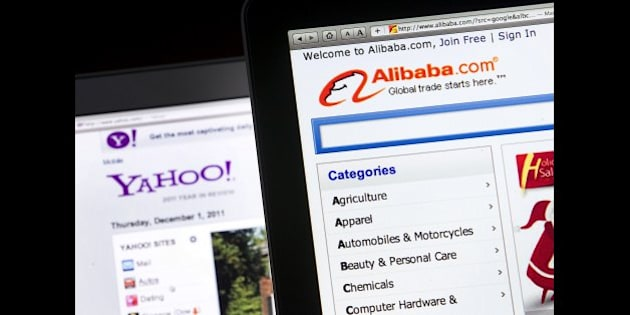 The Yahoo! Inc. and Alibaba Group Holding LTD. websites are displayed on computer monitors for a photograph in New York, U.S., on Thursday, Dec. 1, 2011. Yahoo! Inc., the Internet company exploring strategic options, rose as much as 4.8 percent on the prospect of a bid from a group led by Alibaba Group Holding Ltd. Photographer: Jin Lee/Bloomberg via Getty Images