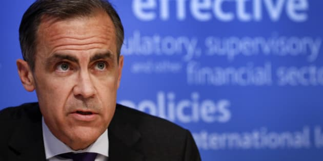 Mark Carney, governor of the Bank of England and chairman of the Financial Stability Board (FSB), speaks during a news conference following the board's plenary meeting at the Bank of England in London, U.K., on Monday, March 31, 2014. Carney said the FSB wants lenders and the International Swaps and Derivatives Association Inc., an industry group, to come up with proposals to write temporary pauses into derivatives contracts struck with banks that hit financial trouble. Photographer: Simon Dawson/Bloomberg via Getty Images