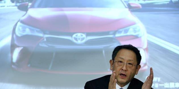 Akio Toyoda, president of Toyota Motor Corp., gestures as he speaks in front of a screen displaying an image of the company's Camry sedan during a news conference in Tokyo, Japan, on Thursday, May 8, 2014. Toyota, the world's largest carmaker, forecast profit will fall from last year's record as demand slumps in Japan, competition intensifies in the U.S. and the yen is no longer the boon it used to be. Photographer: Tomohiro Ohsumi/Bloomberg via Getty Images