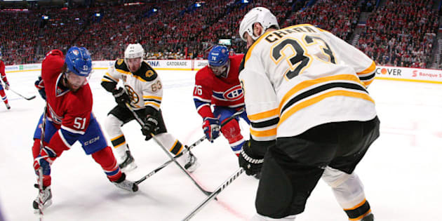 MONTREAL, QC - MAY 8: David Desharnais #51 of the Montreal Canadiens stick handles the puck along the boards as P.K. Subban #76 battles for position against Brad Marchand #63 and Zdeno Chara #33 of the Boston Bruins in Game Four of the Second Round of the 2014 NHL Stanley Cup Playoffs at the Bell Centre on May 8, 2014 in Montreal, Quebec, Canada. (Photo by Francois Laplante/Freestyle Photography/Getty Images)