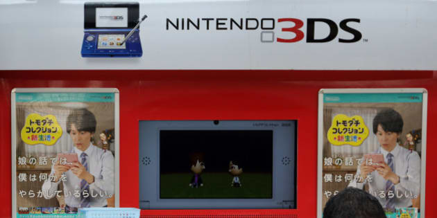 A pedestrian walks past an advertisement for Nintendo Co.'s 3DS handheld game console outside an electronics store in Tokyo, Japan, on Tuesday, April 23, 2013. Nintendo, the world's largest maker of video-game machines, will announce earnings on April 24. Photographer: Tomohiro Ohsumi/Bloomberg via Getty Images