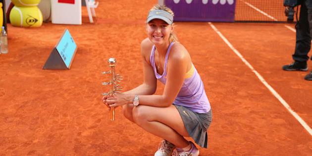 MADRID, SPAIN - MAY 11:  Maria Sharapova of Russia holds her winners trophy after her three set victory against Simona Halep of Romania in their final match during day nine of the Mutua Madrid Open tennis tournament at the Caja Magica on May 11, 2014 in Madrid, Spain.  (Photo by Clive Brunskill/Getty Images)