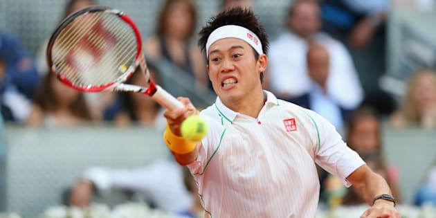 MADRID, SPAIN - MAY 11:  Kei Nishikori of Japan plays a forehand against Rafael Nadal of Spain in their final match during day nine of the Mutua Madrid Open tennis tournament at the Caja Magica on May 11, 2014 in Madrid, Spain.  (Photo by Clive Brunskill/Getty Images)