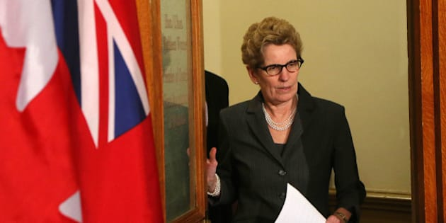 TORONTO, ON - MARCH 27: Kathleen Wynne addresses the media after a bombshell revelation that the former premier's top aide is suspected of committing breach of trust. Premier Kathleen Wynne announced she is enacting new rules to keep political staff from involvement in commercial decisions. Toronto, March 27, 2014.        (Rene Johnston/Toronto Star via Getty Images)