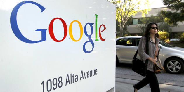 A pedestrian walks past Google Inc. signage displayed at company headquarters in Mountain View, California, U.S., on Thursday, Oct. 13, 2011. Google Inc. is expected to announce quarterly eanrings today after U.S. financial markets close. Photographer: Tony Avelar/Bloomberg via Getty Images