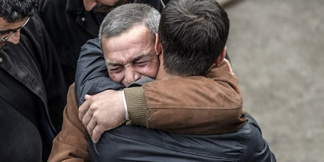 Two men react after the death of a relative on May 14, 2014 following an explosion and fire in a coal mine in the western Turkish province of Manisa killed at least 201 people and hundreds remain trapped underground.   AFP PHOTO/BULENT KILIC        (Photo credit should read BULENT KILIC/AFP/Getty Images)