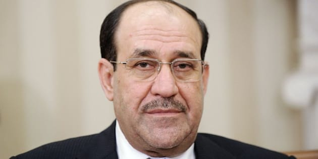 WASHINGTON, DC - NOVEMBER 01: Iraqi Prime Minister Nouri Al-Maliki looks on during a meeting with U.S. President Barack Obama in the Oval Office at the White House November 1, 2013 in Washington, DC.  Al-Maliki was expected to request additional U.S. assistance in battling a rising wave of violence in Iraq.  (Photo by Olivier Douliery-Pool/Getty Images)