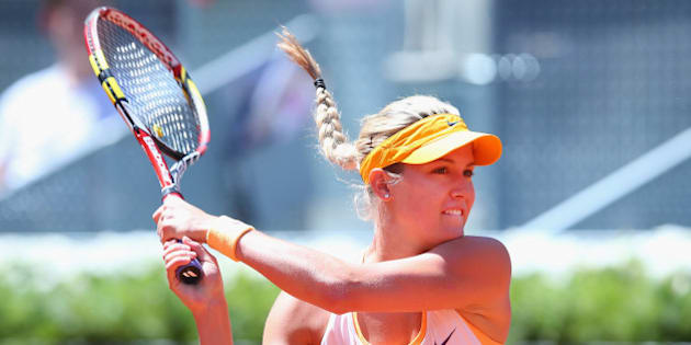 MADRID, SPAIN - MAY 05:  Eugenie Bouchard of Canada in action against Agnieszka Radwanska of Poland during day three of the Mutua Madrid Open tennis tournament at the Caja Magica on May 5, 2014 in Madrid, Spain.  (Photo by Julian Finney/Getty Images)