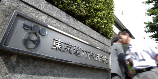 The Tokyo Electric Power Co. (Tepco) logo is displayed outside the company's headquarters in Tokyo, Japan, on Wednesday, June 27, 2012. Tepco won approval from shareholders to give the government control of the world's former biggest private electricity utility. Photographer: Kiyoshi Ota/Bloomberg via Getty Images
