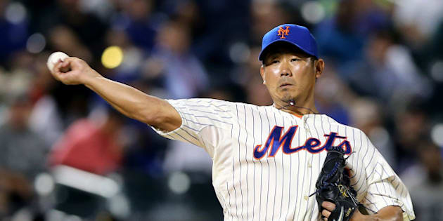 NEW YORK, NY - MAY 20:  Daisuke Matsuzaka #16 of the New York Mets sends the ball to first in an attempt to pick off Yasiel Puig of the Los Angeles Dodgers at first base in the eighth inning on May 20, 2014 at Citi Field in the Flushing neighborhood of the Queens borough of New York City.  (Photo by Elsa/Getty Images)