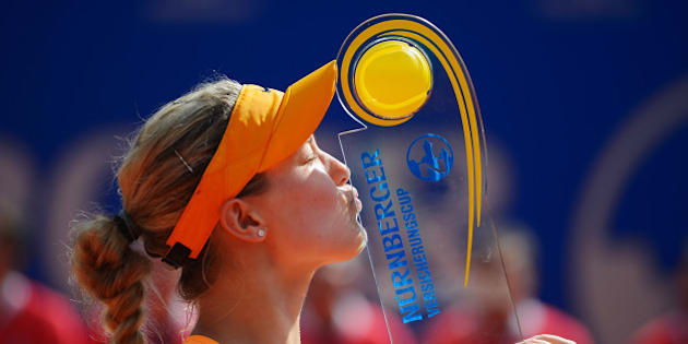 NUREMBERG, GERMANY - MAY 24:  Eugenie Bouchard of Canada kisses the trophy after defeating Karolina Pliskova of Czech Republic during Day 8 of the Nuernberger Versicherungscup on May 24, 2014 in Nuremberg, Germany.  (Photo by Dennis Grombkowski/Bongarts/Getty Images)