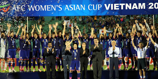 HO CHI MINH CITY, VIETNAM - MAY 25:  Japan celebrates with the Asian Cup Trophy after they defeated Australia 1-0 during the AFC Women's Asian Cup Final match between Japan and Australia at Thong Nhat Stadium on May 25, 2014 in Ho Chi Minh City, Vietnam.  (Photo by Stanley Chou/Getty Images)
