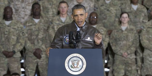 US President Barack Obama addresses US troops during a surprise visit to Bagram Air Field, north of Kabul, in Afghanistan, May 25, 2014, prior to the Memorial Day holiday. AFP PHOTO / Saul LOEB        (Photo credit should read SAUL LOEB/AFP/Getty Images)