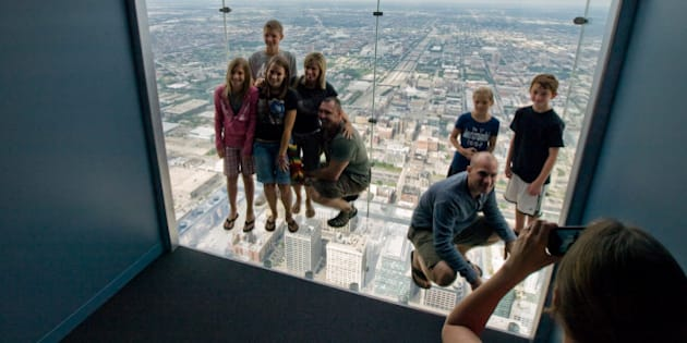 """Everyone, and I mean EVERYONE just had to have their picture taken standing in one of the new glass boxes on the 103rd floor of the Sears Tower.   And yes, I was one of those people....  More info from """"The Mail"""" <a href=""""http://www.dailymail.co.uk/news/worldnews/article-1196967/Dont-l.."""" rel=""""nofollow"""">www.dailymail.co.uk/news/worldnews/article-1196967/Dont-l..</a>.  The Chicago Skydeck: <a href=""""http://www.the-skydeck.com/index.asp"""" rel=""""nofollow"""">www.the-skydeck.com/index.asp</a>  The Chicago Skydeck Flickr stream: <a href=""""http://www.flickr.com/photos/skydeckchicago/"""">www.flickr.com/photos/skydeckchicago/</a>  Friday, July 3, 2009  Chicago Skydeck Sears Tower Chicago, Illinois, USA  Olympus E-510 DSLR Olympus ED 9-18mm f.4-5.6 wide-angle zoom ISO 400 RAW"""