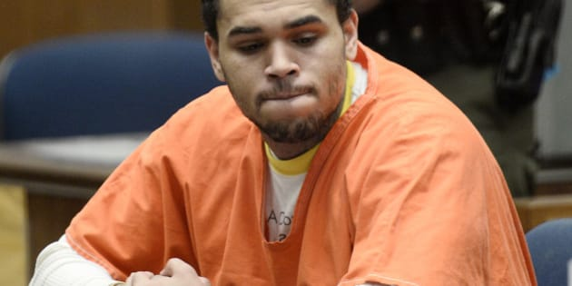 LOS ANGELES-CA-MAY 9: R&B singer Chris Brown (C) appears in court for a probation violation hearing in Los Angeles Court on May 9, 2014 in Los Angeles, California.  Chris Brown was sentenced to an additional year in jail, serving another 131 days after credit for days already served. (Photo by Paul Buck-Pool\Getty Images)