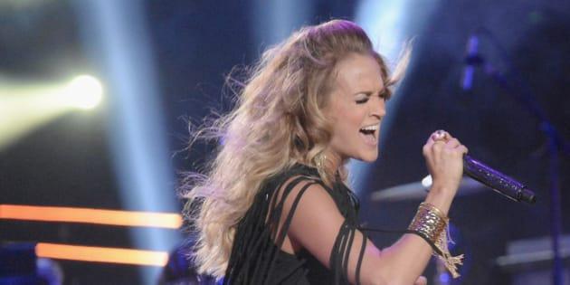 NASHVILLE, TN - JUNE 04:  Carrie Underwood and Miranda Lambert perform during the 2014 CMT Music awards at the Bridgestone Arena on June 4, 2014 in Nashville, Tennessee.  (Photo by Jeff Kravitz/FilmMagic)