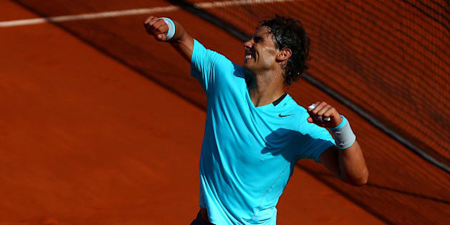 PARIS, FRANCE - JUNE 06:  Rafael Nadal of Spain celebrates victory in his men's singles match against Andy Murray of Great Britain on day thirteen of the French Open at Roland Garros on June 6, 2014 in Paris, France.  (Photo by Dan Istitene/Getty Images)