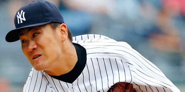 NEW YORK, NY - JUNE 05:  Masahiro Tanaka #19 of the New York Yankees in action against the Oakland Athletics at Yankee Stadium on June 5, 2014 in the Bronx borough of New York City. The Yankees defeated the Athletics 2-1.  (Photo by Jim McIsaac/Getty Images)