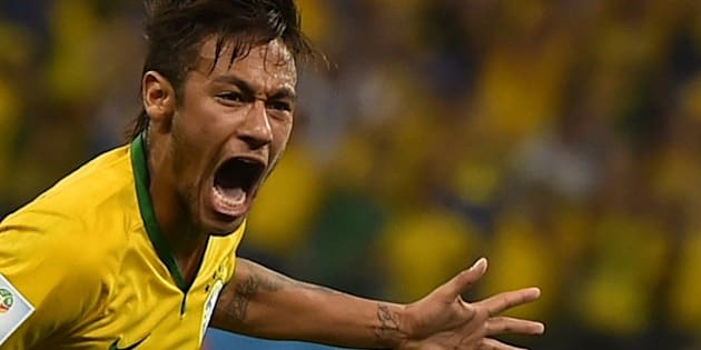 Brazil's forward Neymar celebrates scoring during a Group A football match between Brazil and Croatia at the Corinthians Arena in Sao Paulo during the 2014 FIFA World Cup on June 12, 2014. AFP PHOTO / FABRICE COFFRINI        (Photo credit should read FABRICE COFFRINI/AFP/Getty Images)
